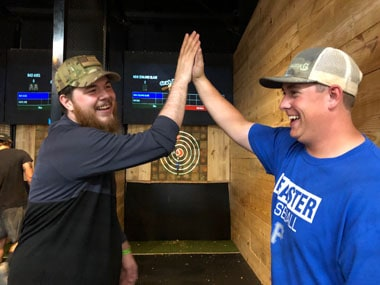 bachelor and best men at axe throwing party