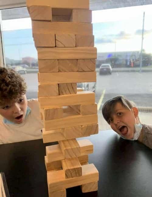 2 boys playing big jenga