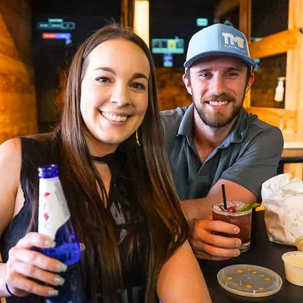couple at axe throwing bar near College Station